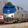 An Amtrak Lincoln Corridor Service train between Chicago and St. Louis flies around the broad curve at Elwood, Illinois in December of 2011.  The train is operating over Union Pacific rails; recent FRA regulatory actions in reference to both freight and passenger train operating procedures and speed limits are likely to produce service slowdowns that may impact both costs and service availability for shippers.  (Copyright 12/2011 Paul Burgess: used with permission)