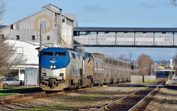 Amongst this week's notes; the FRA intends to reinforce highway grade crossing safety. Amtrak's train #11, the Coast Starlight, roars over an example in Kent, Washington on February 20th. Image © Nikki Burgess 2/2016; all rights reserved.