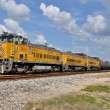 Union Pacific and BNSF have sent letters to Senator John Thune (R-SD) declaring that if the PTC mandate deadline is not extended, they will cease carrying any TIH or passenger traffic on affected lines effective January 1st, 2016.  Here a UP switch job handles tank cars in Laporte, Texas on the Houston Ship Channel in 2013.  Chemical manufacturers would be one segment of industry among many negatively affected by such an embargo. (Image (c) Nikki Burgess 9/2014; all rights reserved)