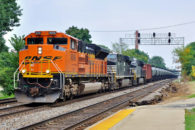 The FRA issued an Emergency Information Collection Request (EICR) in reference to the repairs it directed shippers to make to the nation's fleet of DOT-111 rail tank cars last week.  A train of such cars passes west through Hinsdale, Illinois in August of 2014. Image © 8/2014 by Nikki Burgess; all rights reserved.