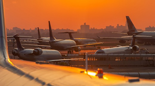 Sunset at the airport with airplanes ready to take off.