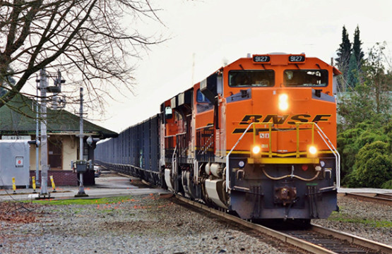 "The Federal Railroad Administration (FRA) seeks input on so-called ""Quiet Zones"" at highway grade crossings to reduce noise without compromising safety. A BNSF train sounds its horns as it crosses a road in Kent, Washington on March 5th, 2016. (© 3/2016) by Nikki Burgess; all rights reserved.)"