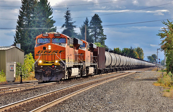The FRA has issued a fresh warning regarding potential integrity flaws in the bottom fitting welds on some DOT-111 tanks cars, noting that recently discovered flaws on some cars could increase the odds of a release and requiring operators to take appropriate mitigating action. A train of DOT-111 tank cars rolls north through Kent, Washington on the BNSF Railway on Saturday, October 1st, 2016. Image © 10/2016 by Nikki Burgess; all rights reserved.