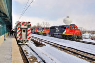 The Surface Transportation Board (STB) is being asked to help solve a control dispute involving a commuter rail agency and a common carrier freight railroad that share track.  At issue—hazardous materials.  Here, a CN freight train passes a Metra Electric Commuter train (Note: NOT the entities involved in the dispute) in Matteson, Illinois in February, 2015. © 2/2015 by Nikki Burgess; all rights reserved.